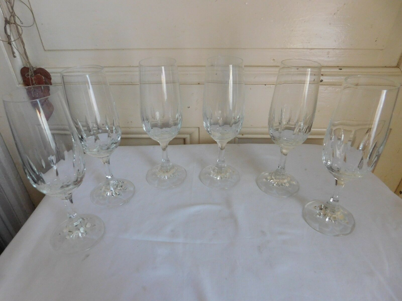 Set of six flutes champagne cristal carved legs to faces