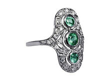 Art-Deco Ring mit Smaragden und Diamanten.