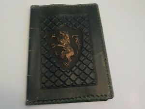 Antique-dark-green-leather-book-cover-crest-embossed-tooled-leather