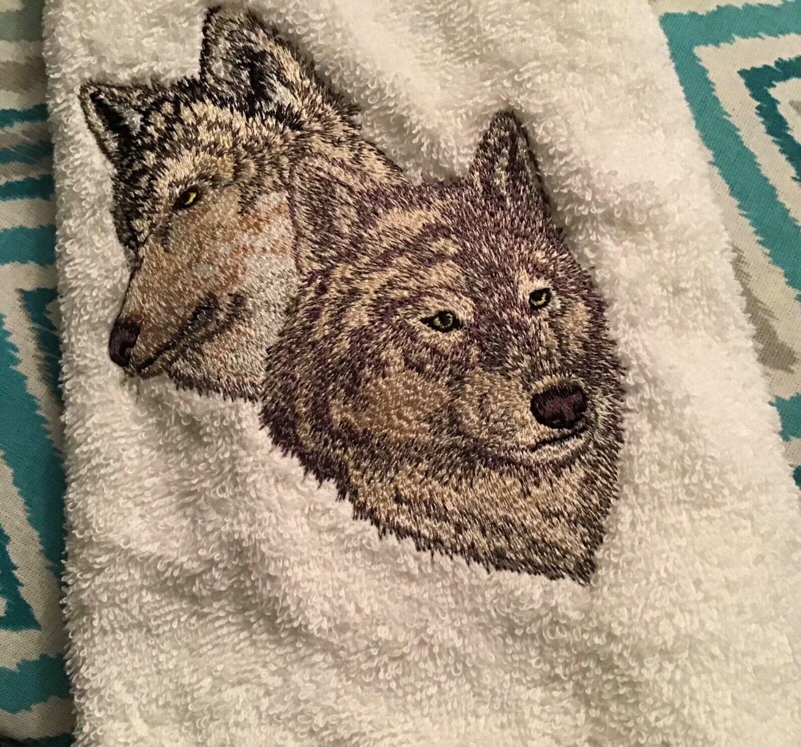 Machine embroidered hand towel, wolf design