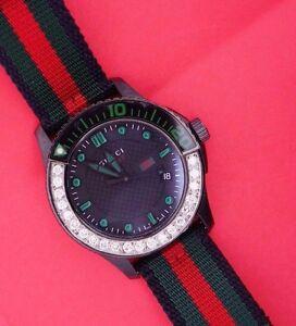 5ccda77ce19 Gucci YA126229 G Timeless Nylon Strap Black Dial Mens Sports Watch ...