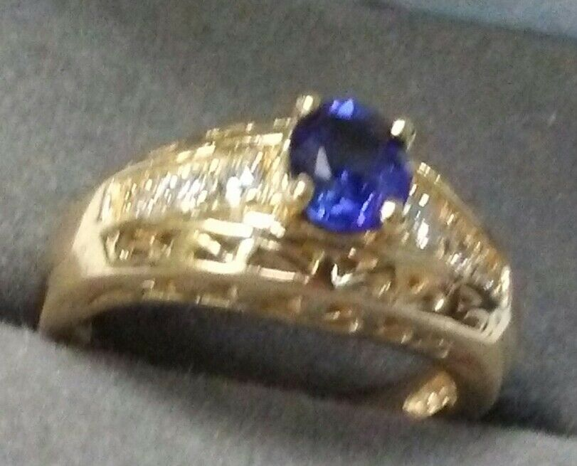 Designer 14K Yellow gold Ring with Old Style Sapphire Stone lined with Diamonds