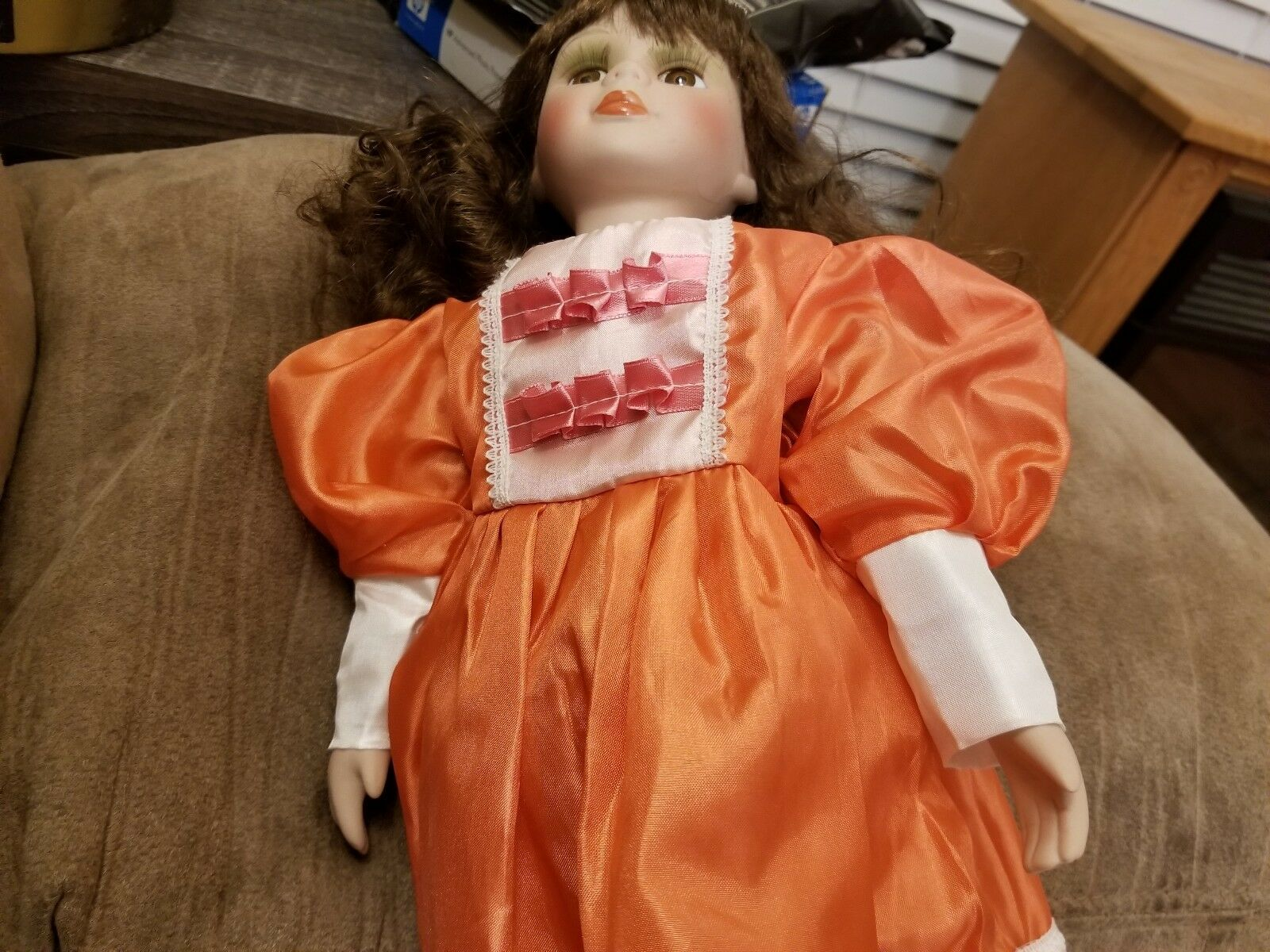 PORCELAIN DOLL . . . Doll comes with a built on stand and dress seems home made 018103