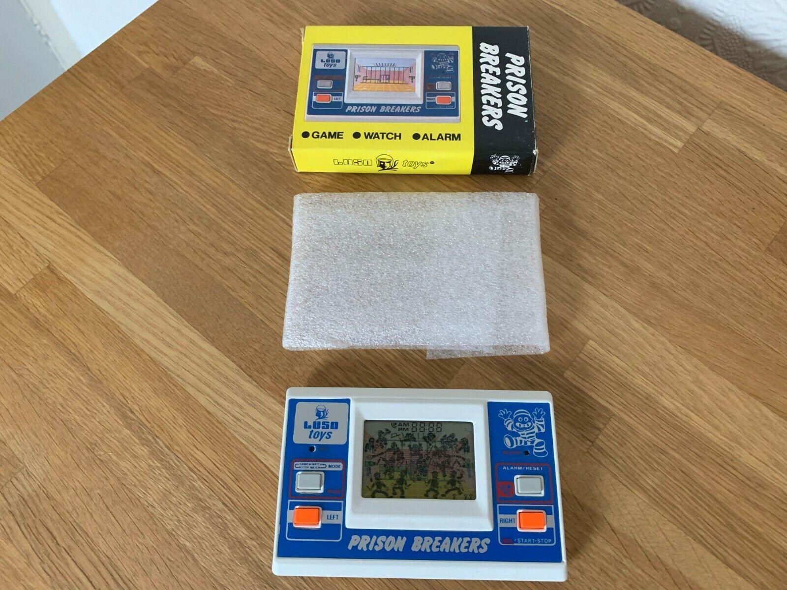 Raro en Caja luso Juguetes prisión interruptores Vintage 1984 LCD juego electrónico -  como Nuevo .