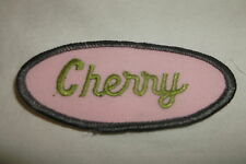 CHERRY USED EMBROIDERED  SEW ON NAME PATCH OVAL GREY BORDER WITH OLIVE ON PINK