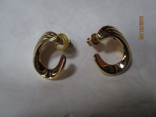 Vintage gold tone open swirl hoop pierced stud earrings signed Monet  classic