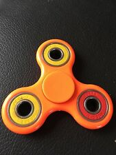 orange multi ring triple finger hand spinner fidget spinning toy steel bearing
