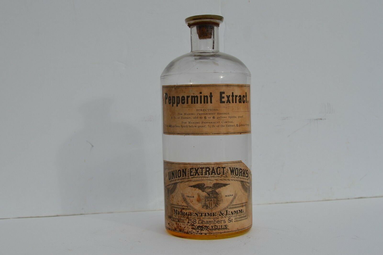 EARLY UNION EXTRACT WORKS  BOTTLE BY MERGENTIME & LAMM IN NEW YORK PAPER LABEL  a lot of concessions