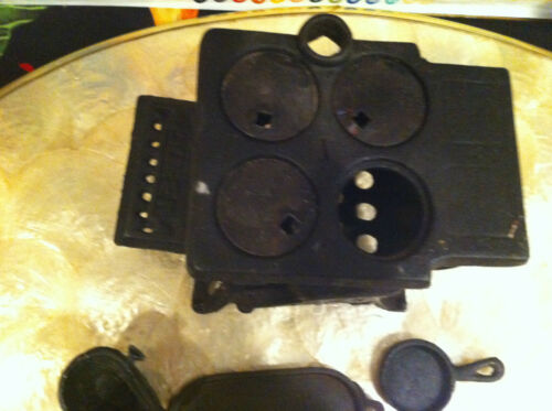 Cute little black cast metal Queen salesman Sample Stove with attachments