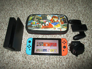 Nintendo Switch System 32GB Console w/Neon Blue & Red Joy-Cons Dock Carry Case