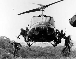 Huey Helicopter For Sale >> Old Photo. Soldiers Jumping - Bell UH-1 Iroquois (Huey) Helicopter | eBay
