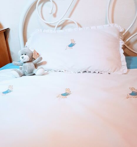cot//cot bed frilled pillowcase with blue or pink personalisation Peter rabbit