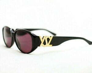 Yves-Saint-Laurent-sunglasses-31-5506-vintage-oval-big-logo-gold-women-black