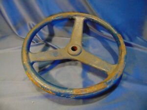 12-034-Cast-iron-steering-wheel-OPEN-arrow-pipe-valve-door-industrial-Vtg-blue-art