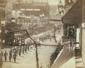 Parade-through-the-streets-of-Deadwood-South-Dakota-in-1888-Photo-Print