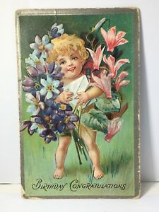 Victorian-Embossed-Postcard-Child-With-Flowers
