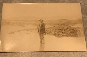 rppc-Postcard-Man-With-Hat-Standing-In-Water-On-Beach
