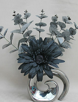 ARTIFICIAL SILK BLACK GERBERA WITH LEAF SPRAY IN SILVER METALLIC FOSSIL VASE