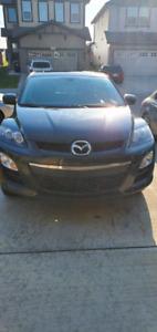 Mazda CX7 AWD SUV ,low kms ,Active status, No hail damage .