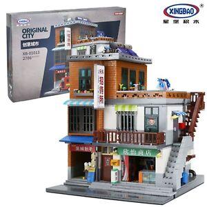 Bausteine-Xingbao-Creative-City-Staedtischen-Dorfbausteine-Spielzeug-Toys-2706PCS