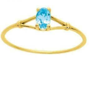 Bague-en-or-jaune-18-carats-sertie-d-039-une-Aigue-Marine-ou-topaze-bleue-ovale