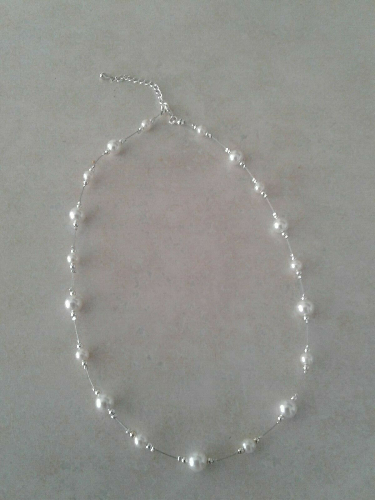 Vintage Long Classy Beautiful Floating White Round mother of pearls and glass beads in a Silver chain necklace.