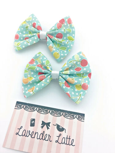 Vintage Inspired Pin Up Light Blue with Cherries Print Medium Fabric Hair Bow
