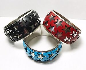 Set-Of-Three-Vintage-Star-Theme-Bangle-Bracelets-In-Blue-Red-And-Black