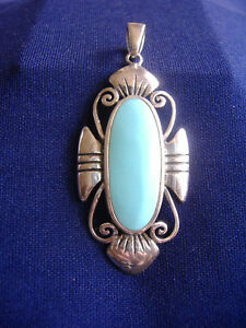 VINTAGE-STYLIZED-FLOWER-AND-TURQUOISE-PENDANT-STERLING-SILVER