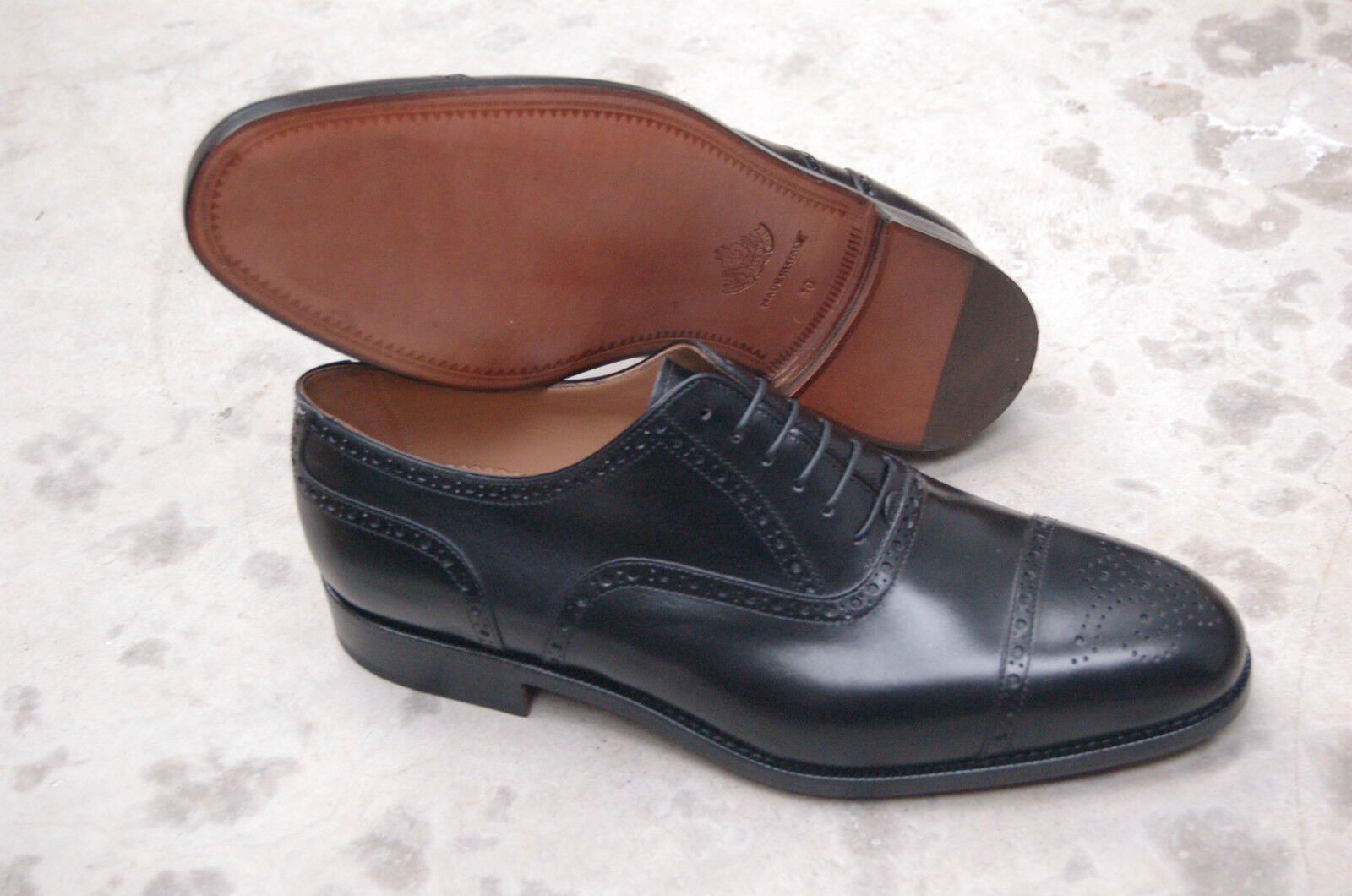 MAN - OXFORD WINGTIP - BLACK CALF PERFS AND MEDALLION - LEATHER SOLE - BLAKE