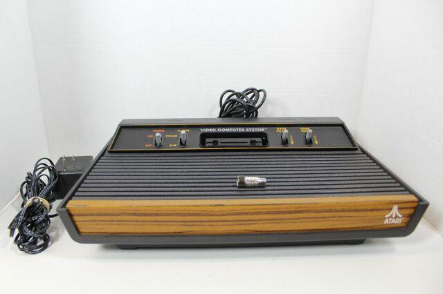 Atari 2600 4 Switch Woodgrain Video Game Console System w RF & AC Adapter