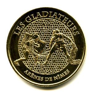 30 NIMES Les gladiateurs, 2014, Monnaie de Paris - France - Type: Monnaie de Paris Thme: Patrimoine culturel Epoque: XXIme sicle Genre: Médaille Touristique Année: 2014 Métal: Nordic Gold - France