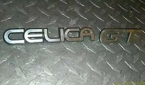 2-Toyota-Celica-Emblems-82-83-84-85-Notchback-Logo-AND-GT-EMBLEM-Chrome-OEM-RARE