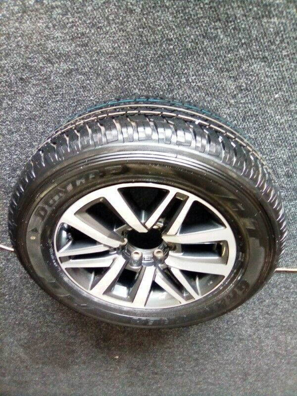 """18"""" Toyota Hilux/Fortuner mag with brand new 265/60/18 Dunlop  AT to use for spare R3500."""