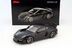 Porsche-Cayman-GT4-noir-metalique-1-18-Schuco