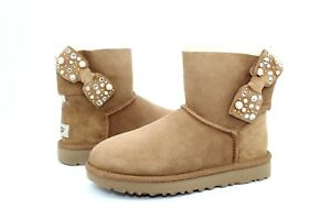 0d4c591e2aa UGG MINI BAILEY BOW BRILLIANT CHESTNUT BLING SUEDE SHEEPSKIN BOOTS ...