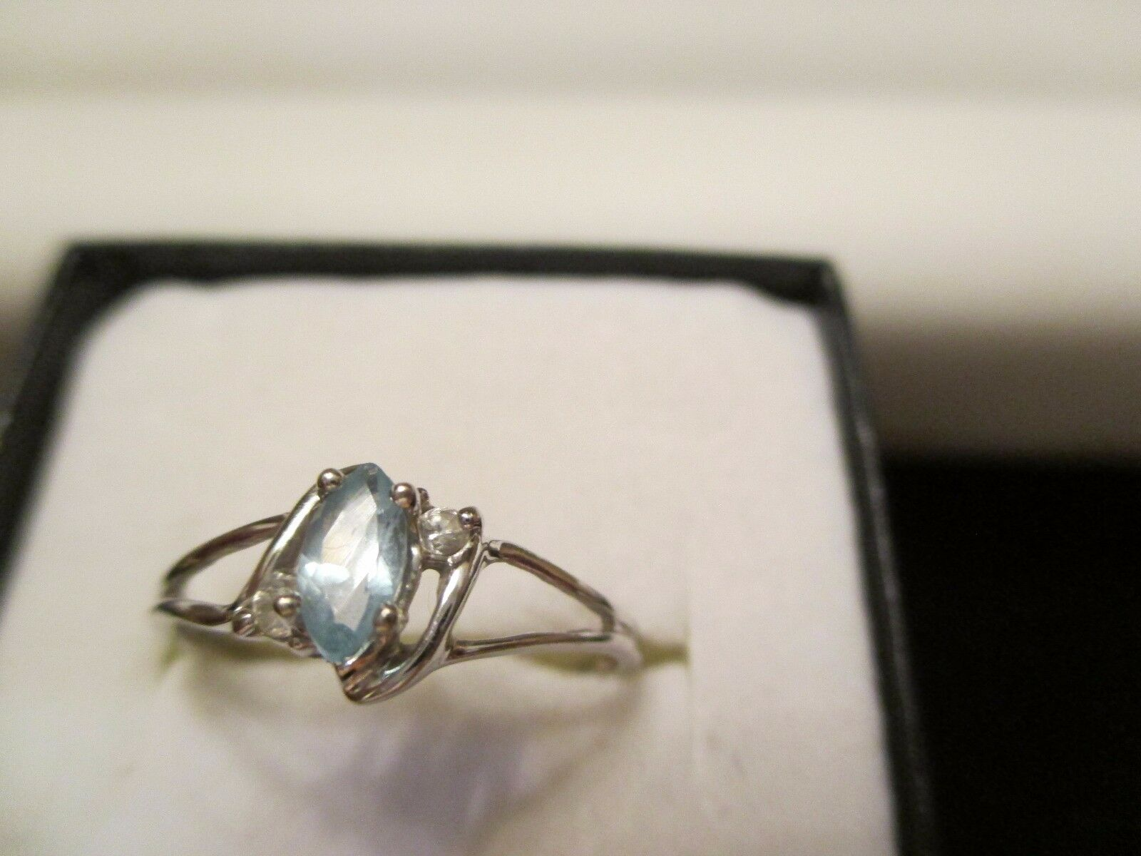 10K White gold bluee Topaz and Cubic Zirconia Ring-Size 7