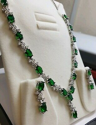 White gold finish oval green peridot and created diamond earrings necklace set