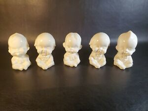 Vintage-set-of-porcelain-baby-figurines-with-expression