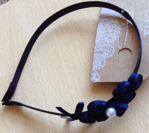 A Pretty Navy Blue Spiral And Knot Ribbon Design Alice Hair Band