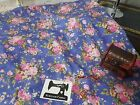 50cm x 150cm wide pink floral on blue cotton lycra 4 way stretch knit fabric