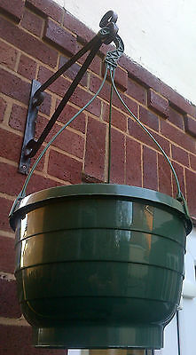 Hanging basket in green plastic with robust easy to use clip on hook