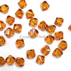3mm Topaz (203) Genuine Swarovski crystal 5328 / 5301 Loose Bicone Beads