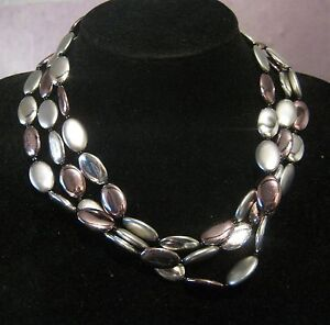 Wonderful-triple-strand-of-oval-plastic-silver-beads-with-nice-clasp