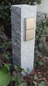 Doppelte-Gartensteckdose-in-Granitpalisade-Edelstahl-Aussensteckdose-gestockt