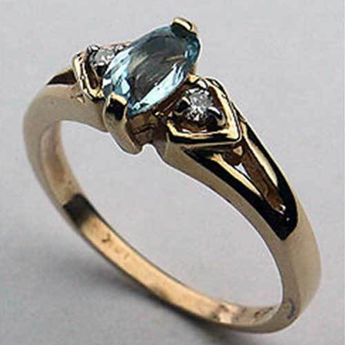 14kt gold bluee Topaz and Diamond Ring