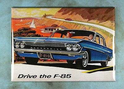 """Vintage  Style Car Ad Fridge Magnet 2 1/2"""" x 3 1/2""""  Oldsmobile F 85 1961 V8"""