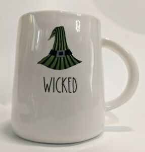 Rae-Dunn-Wicked-Artisan-Collection-Magenta-2-Sided-Halloween-Mug-witch-hat-feet