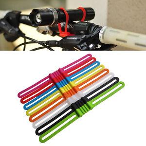Supporto-in-silicone-per-bici-gps-smartphone-torcia-borraccia-universale
