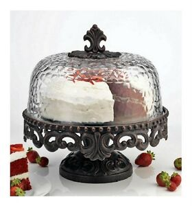Attractive Scrolled Metal Cake Stand With Hammered Glass